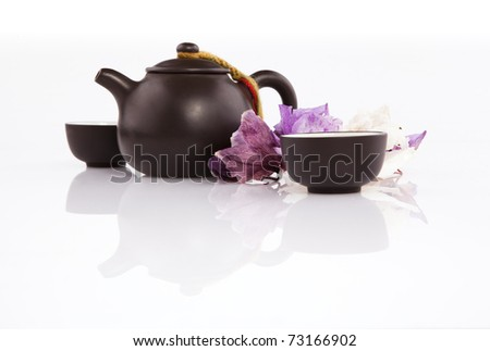 Chinese tea set with pot and cups on white - stock photo