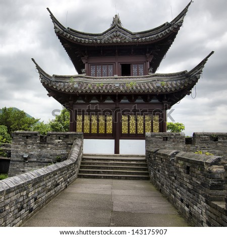 Chinese Temple and the Great Wall - stock photo