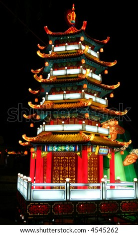 chinese temple at chinese lantern festival celebrating new years - stock photo