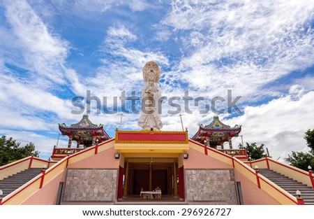 Chinese temple in Thailand  under the blue sky and big  cloud ( Generality in Thailand ,and kind of art decorated in Buddhist church, temple pavilion ,temple hall . They are public) - stock photo