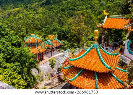 Chinese temple on the Thai island of Koh Phangan. Top view of the roof - stock photo