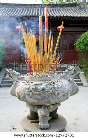 Chinese temple's altar, details - stock photo