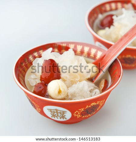 Chinese traditional cuisine, Lotus seed soup with red date and white fungus - stock photo