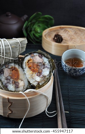 Chinese traditional food Zongzi in bamboo steam container - stock photo