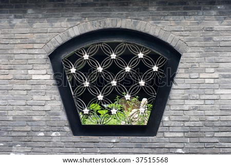 Chinese traditional window with green leaves - stock photo