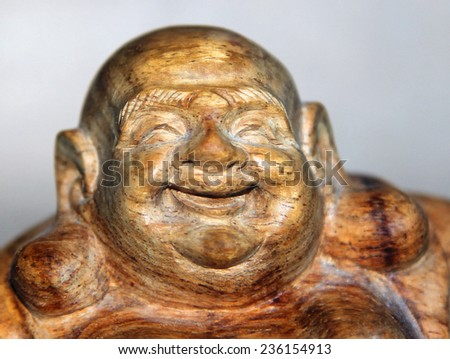 Chinese traditional wooden statue of smiling Mi Le Fo (Maitreya) or Buddha of Future - stock photo