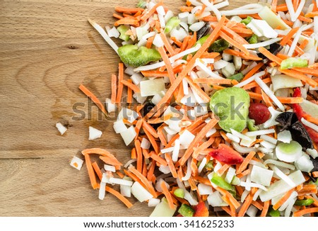 Chinese vegetables sliced in strips on wooden board, top view. - stock photo