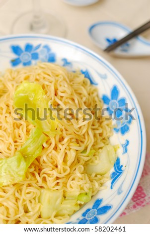 Chinese vegetarian yellow noodles. Suitable for concepts such as diet and slimming, healthy lifestyle, and food and beverage. - stock photo