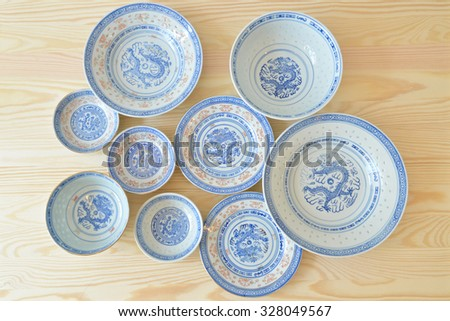 Chinese vintage style blue and white dishes, plate and bowl on the cupboard at home. (top view)  - stock photo