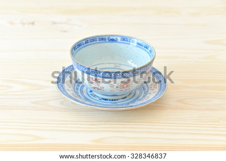Chinese vintage style blue and white dishes, plates and bowls on the cupboard at home.  - stock photo