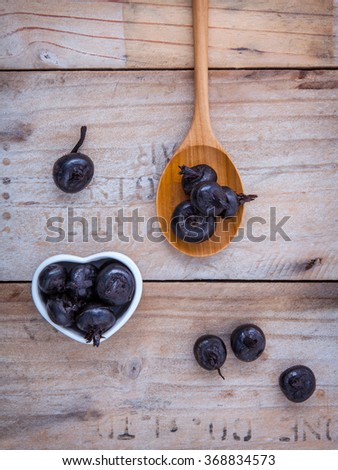 Chinese water chestnut ,water nut or Matai roots in wooden spoon and bowl on rustic old wooden background. - stock photo