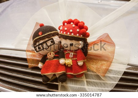 Chinese Wedding doll ,Trapped in car,wedding ceremony in hong kong ,china,Traditional Chinese wedding scenes,vintage color. - stock photo