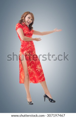 Chinese woman dress traditional cheongsam at New Year and introducing, full length portrait isolated. - stock photo