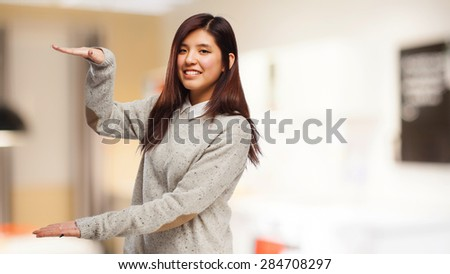 chinese woman showing a size - stock photo