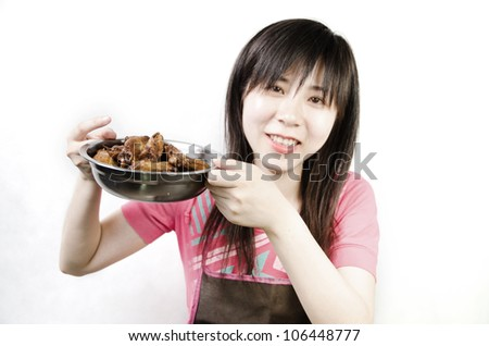 chinese woman with braised chicken wing - stock photo