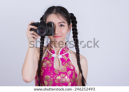 chinese woman with vintage retro camera - stock photo