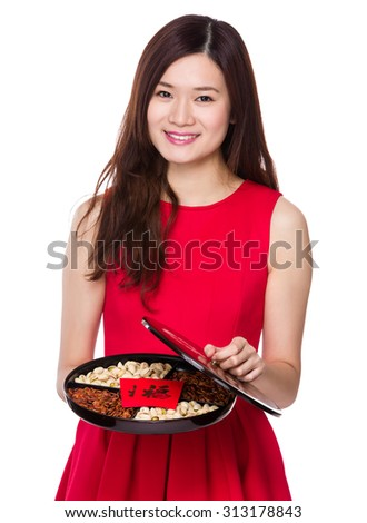 Chinese young woman show with snack tray - stock photo