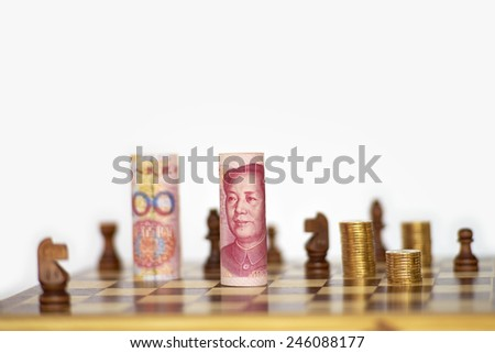 Chinese yuan stand on chess board as king - stock photo