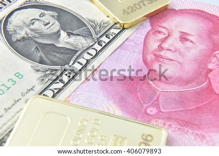 Chinese yuan / US dollar / gold bullion. A concept of China as the US largest foreign creditor which held trillions in US treasuries, reflecting the dramatic expansion of Beijing's economic influence. - stock photo