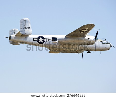 CHINO/CALIFORNIA - MAY 3, 2015: B-25 Mitchell Bomber Aircraft displaying flying tactics at the Planes of Fame Airshow in Chino, California USA - stock photo