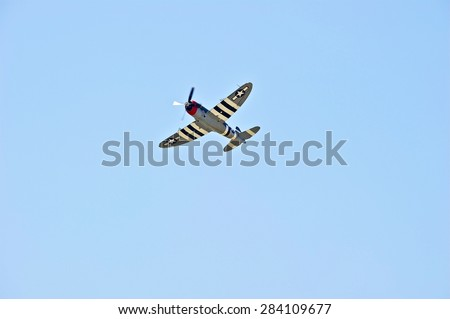 CHINO/CALIFORNIA - MAY 3, 2015: Vintage military aircraft demonstrating its flying agility at the Planes of Fame Airshow in Chino, California USA  - stock photo