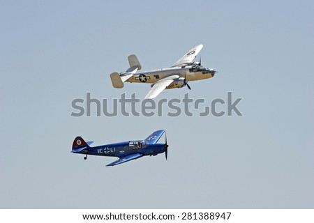 CHINO/CALIFORNIA - MAY 3, 2015: Vintage military aircraft displaying its flying agility at the Planes of Fame Airshow in Chino, California USA  - stock photo