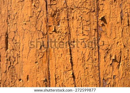 chipped paint on the wall of the old boards texture background - stock photo