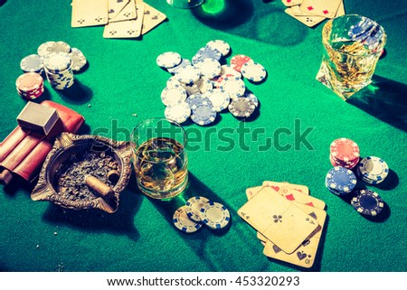 Chips and cards in old gambling table - stock photo