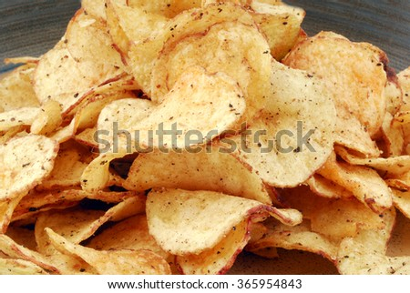chips crisps on plate - stock photo