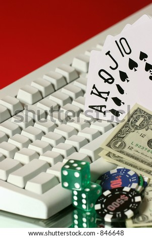 chips, dice, money, card are all on line gaming - stock photo