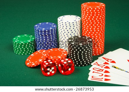 Chips ,dices and royal flush on casino table - stock photo