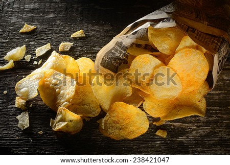 chips in bags on the old board  - stock photo
