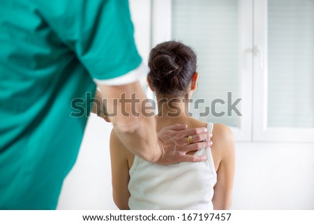 Chiropractor massage the female patient spine and back - stock photo