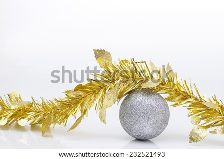 Chirstmas 's ball with golden ribbon for celebration and festival. - stock photo