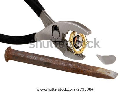 chisel used to pry off watch back as watch is held by pliers - on white background - stock photo