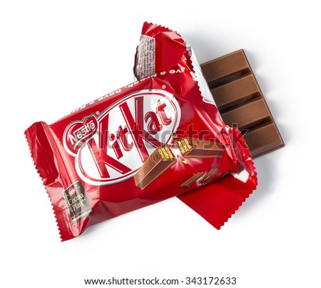 CHISINAU,MOLDOVA - NOVEMBER 14, 2015: Opened Kit Kat chocolate bar. Kit Kat is a chocolate biscuit bar confection that is manufactured by Nestle ISOLATED ON WHITE WITH CLIPPING PATH - stock photo