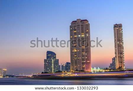 Choaphraya river and modern building  at nigh - stock photo