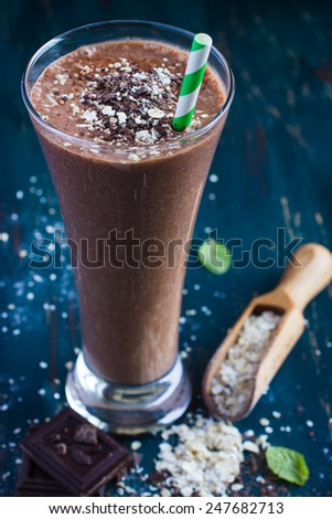 chocolate and banana milk smoothie with oat flakes - stock photo