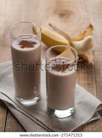 Chocolate and banana smoothie (milkshake) in glass, selective focus - stock photo