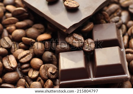 Chocolate and coffee beans. - stock photo