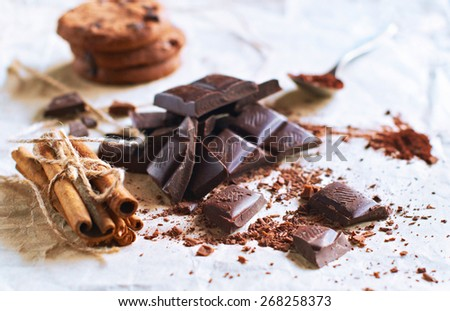 Chocolate and cookies on paper, selective focus - stock photo