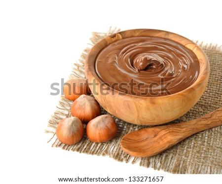 Chocolate and hazelnuts on white background - stock photo