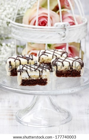 Chocolate and marzipan layer cakes for wedding party. Selective focus - stock photo