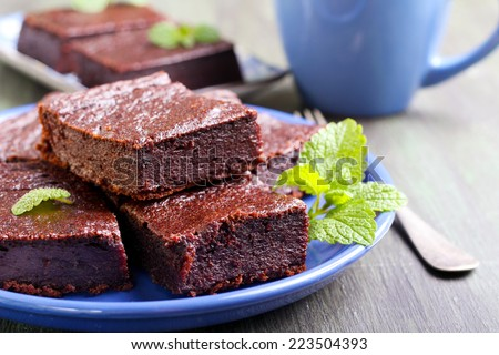Chocolate and pumpkin brownie slices, selective focus - stock photo