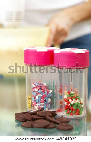 chocolate and sprinkles for home made cake closeup - stock photo