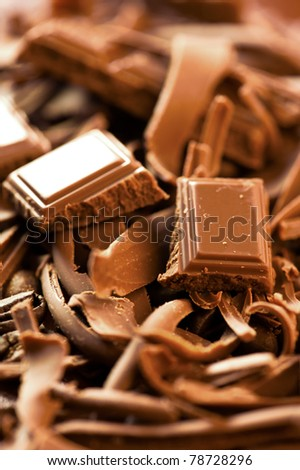 Chocolate background. Bars and strips of chocolate - stock photo