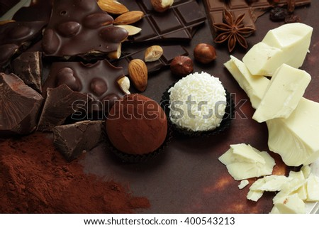 Chocolate background/ nut chocolate/ chocolate bar/ chocolate truffle/ white chocolate - stock photo