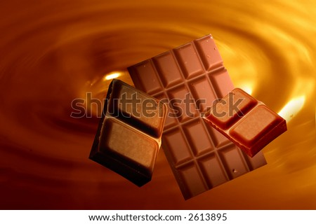 Chocolate background with bars of chocolated - stock photo