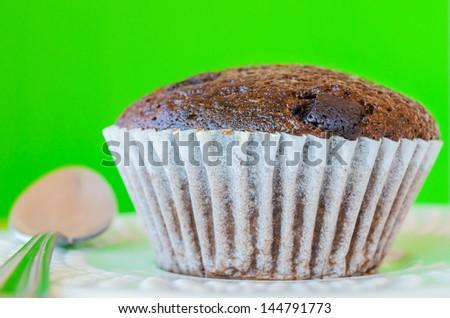 Chocolate banana cupcake with green background - stock photo