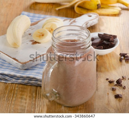 Chocolate banana smoothie in jar. Selective focus - stock photo